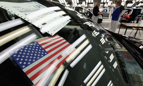 WOLFSBURG, GERMANY - FEBRUARY 25:  A Sticker Showing The U.S. Flag Hangs In The Windshield Of A New Volkswagen Golf 6 Car Destined For Export To The United States At The Volkswagen Factory On February 25, 2011 In Wolfsburg, Germany. Volkswagen And Other German Carmakers Have Recovered From The Financial Crisis Of 2008 And Production Levels Are Reaching Record Levels. The Automobile Industry Is An Integral Part Of Germany's Export-driven Economy.  (Photo By Sean Gallup/Getty Images)